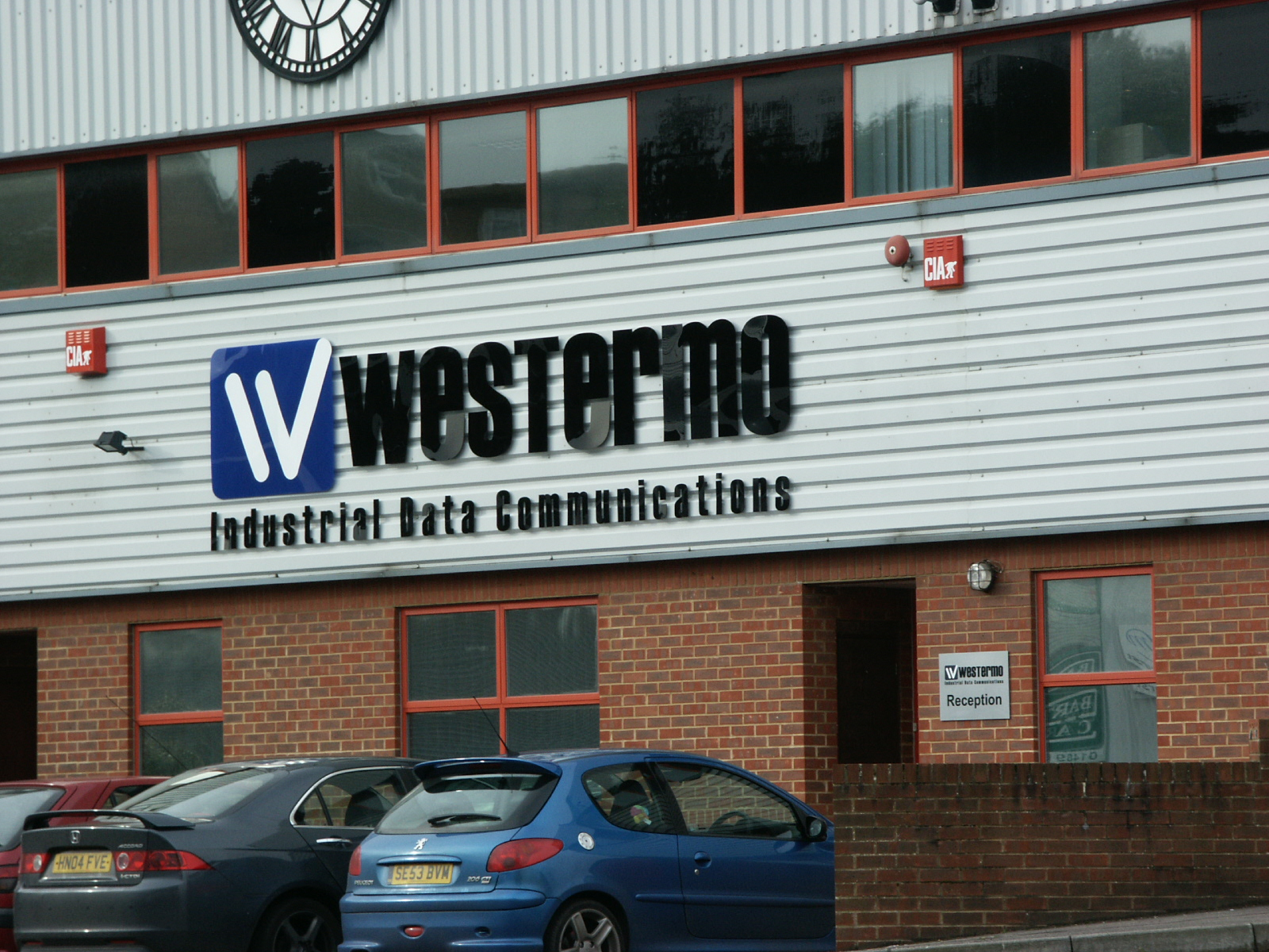 Factory Signs with exterior clock