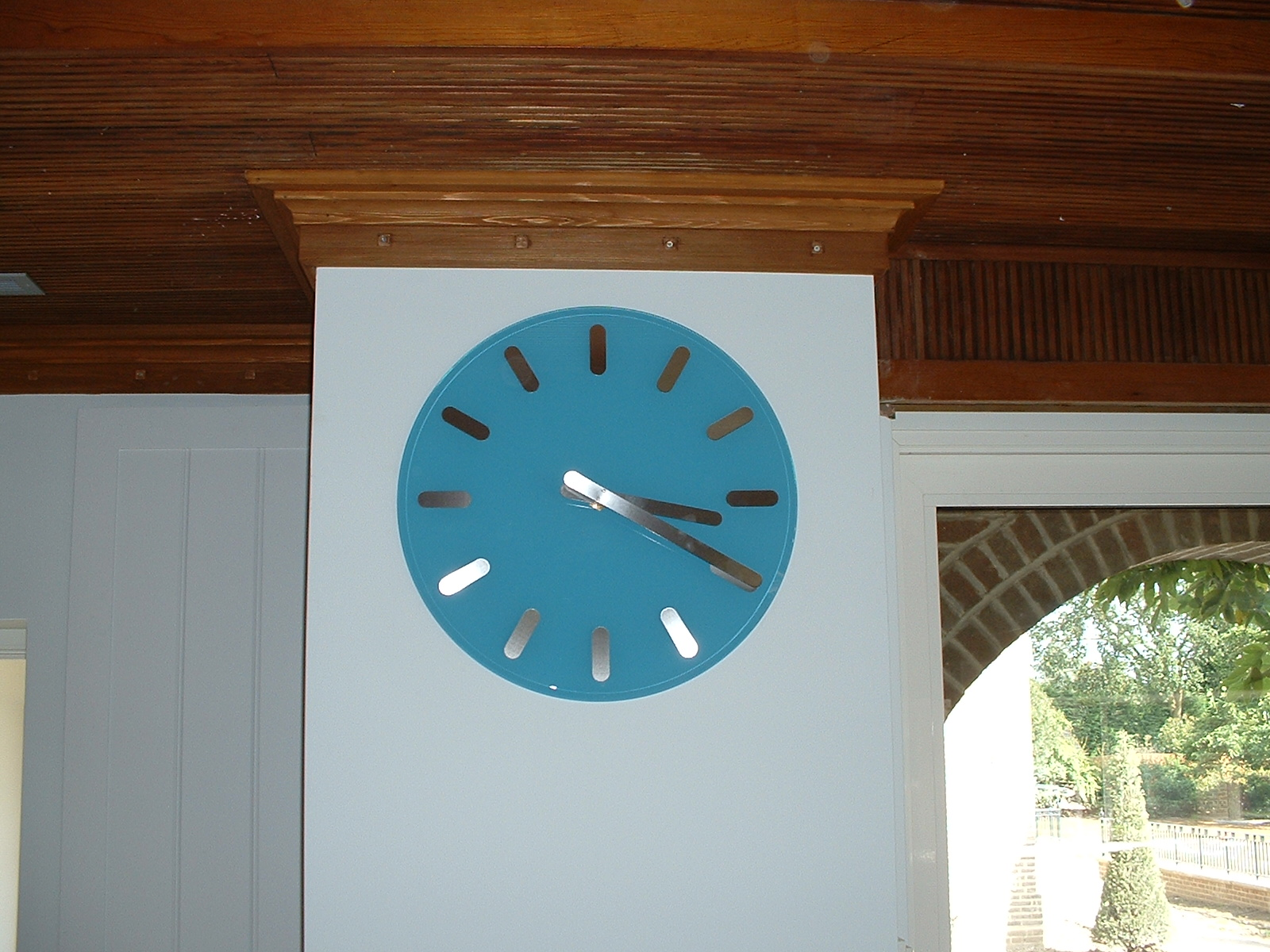 Blue clock with stainless chapters