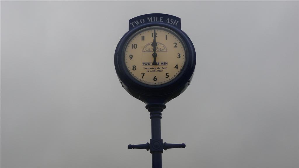 Sign writing on pillar clock