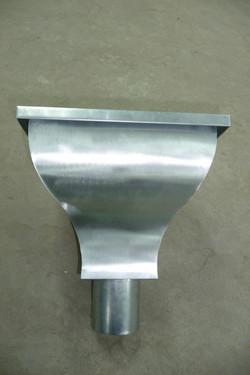 Zinc hopper head