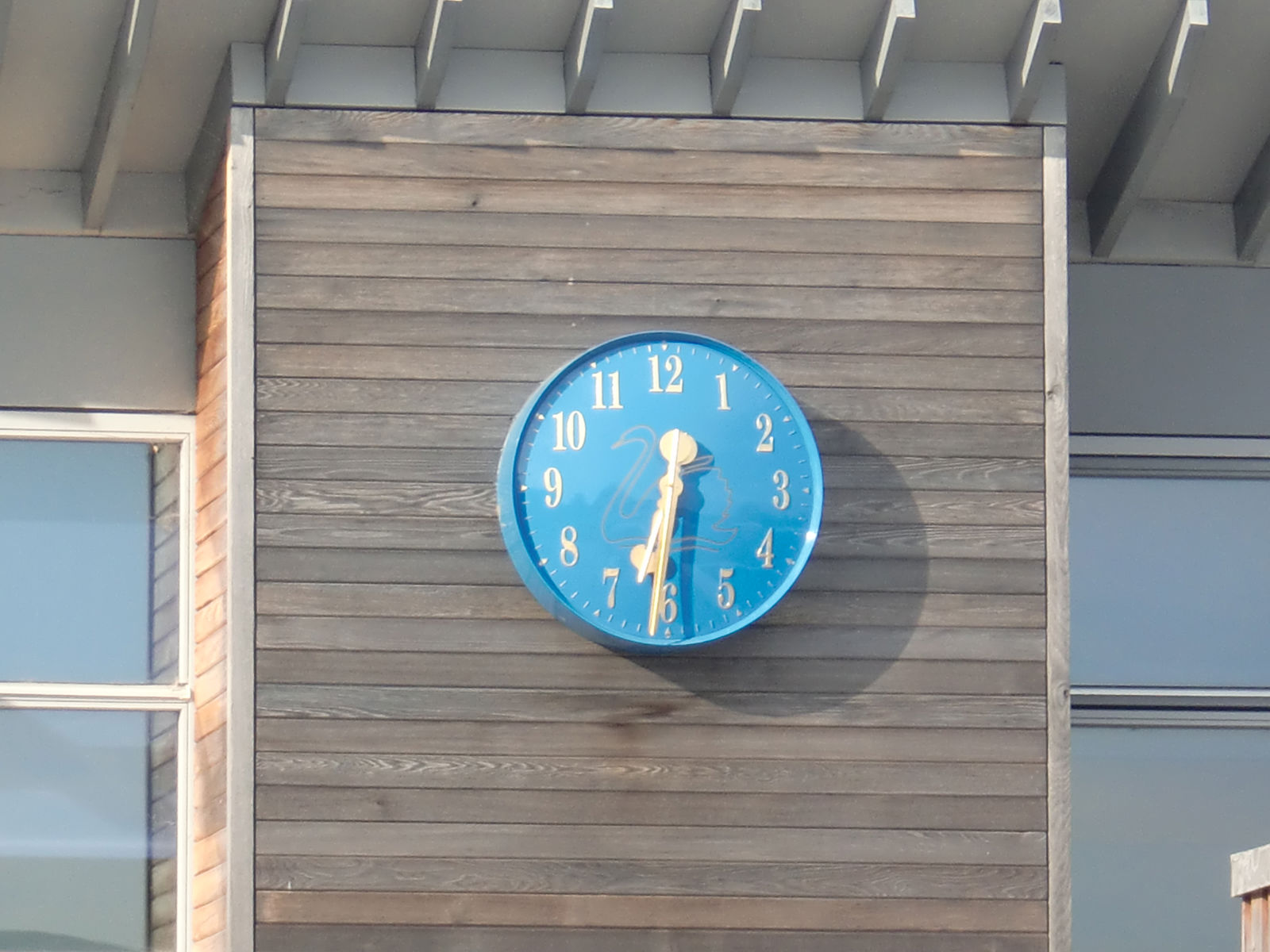 School logo on bezel clock