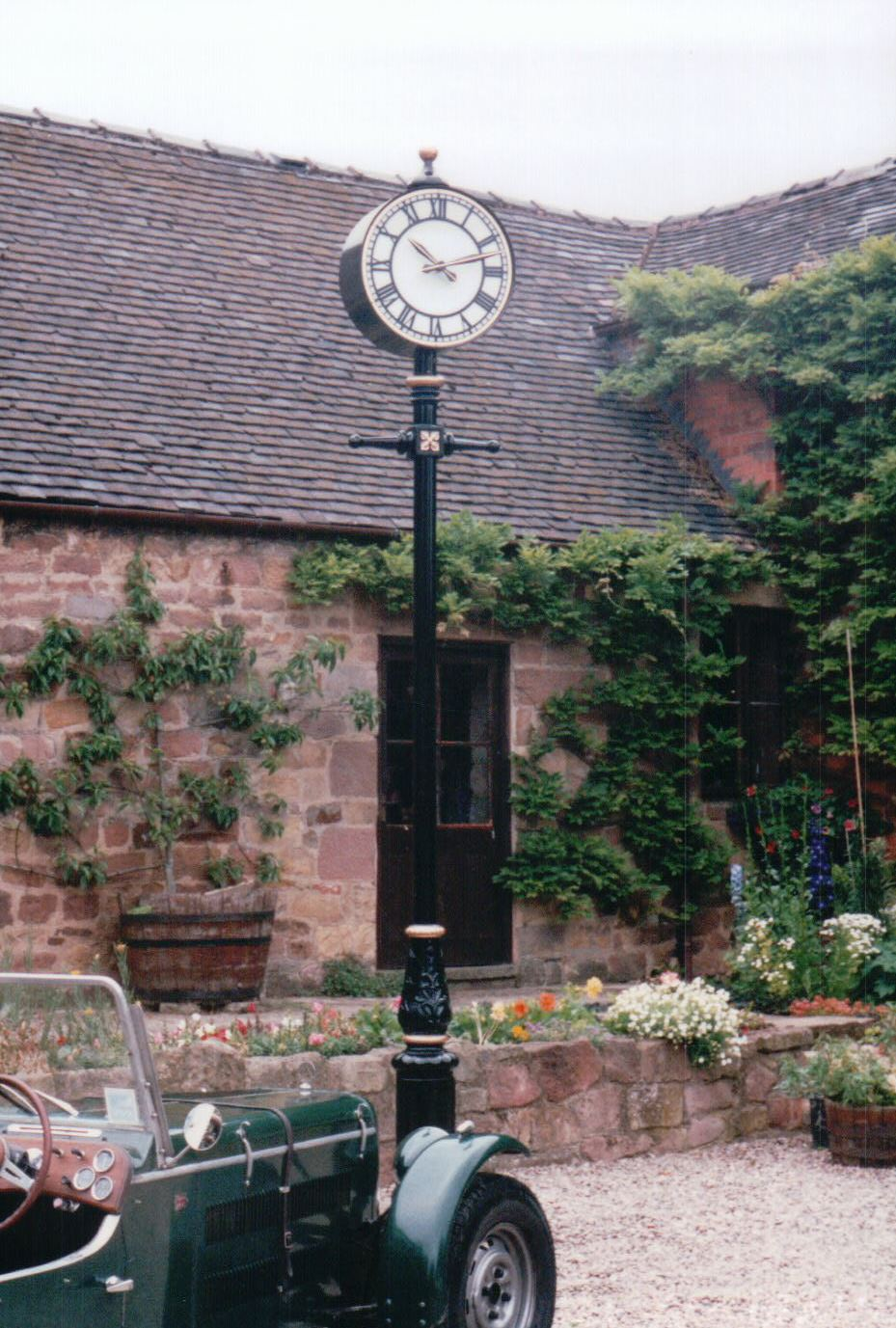 Double sided post mounted clock