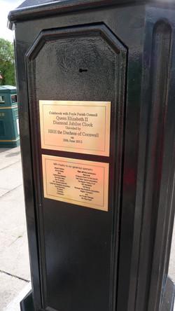Commemorative plaque on pillar clock