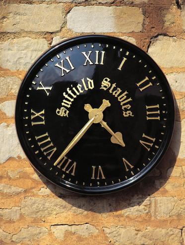 Sign written clock