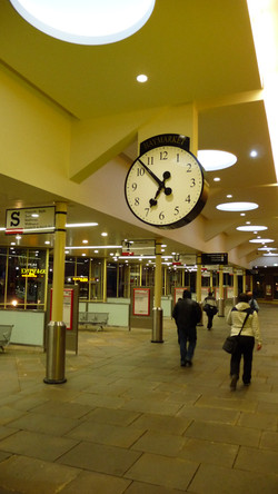 Drum clock above a shopping mall