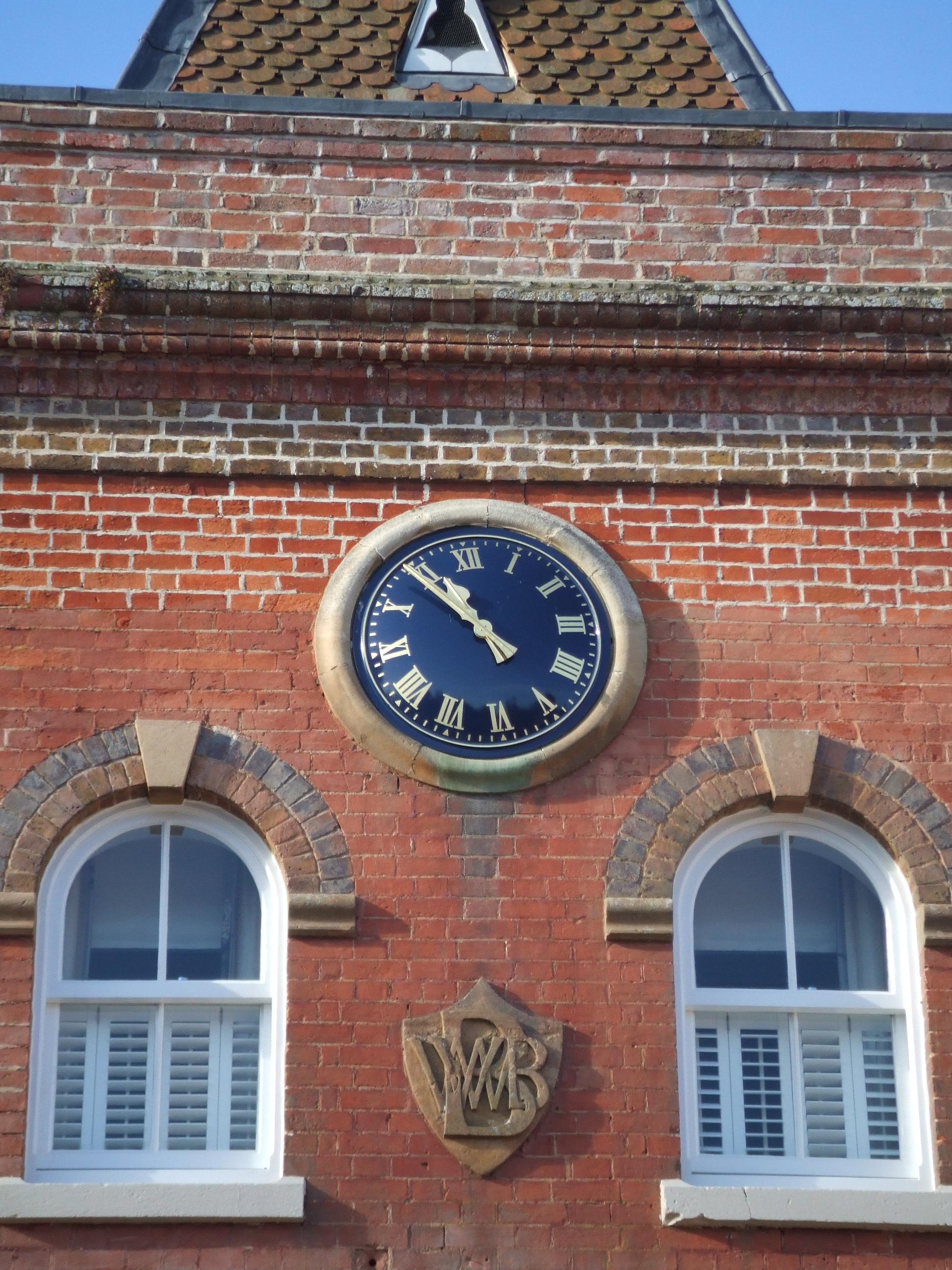 Black and gold clock in bullseye