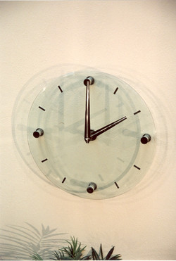 Glass clock with stainless chapters