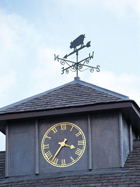 Skeleton exterior clock in gold