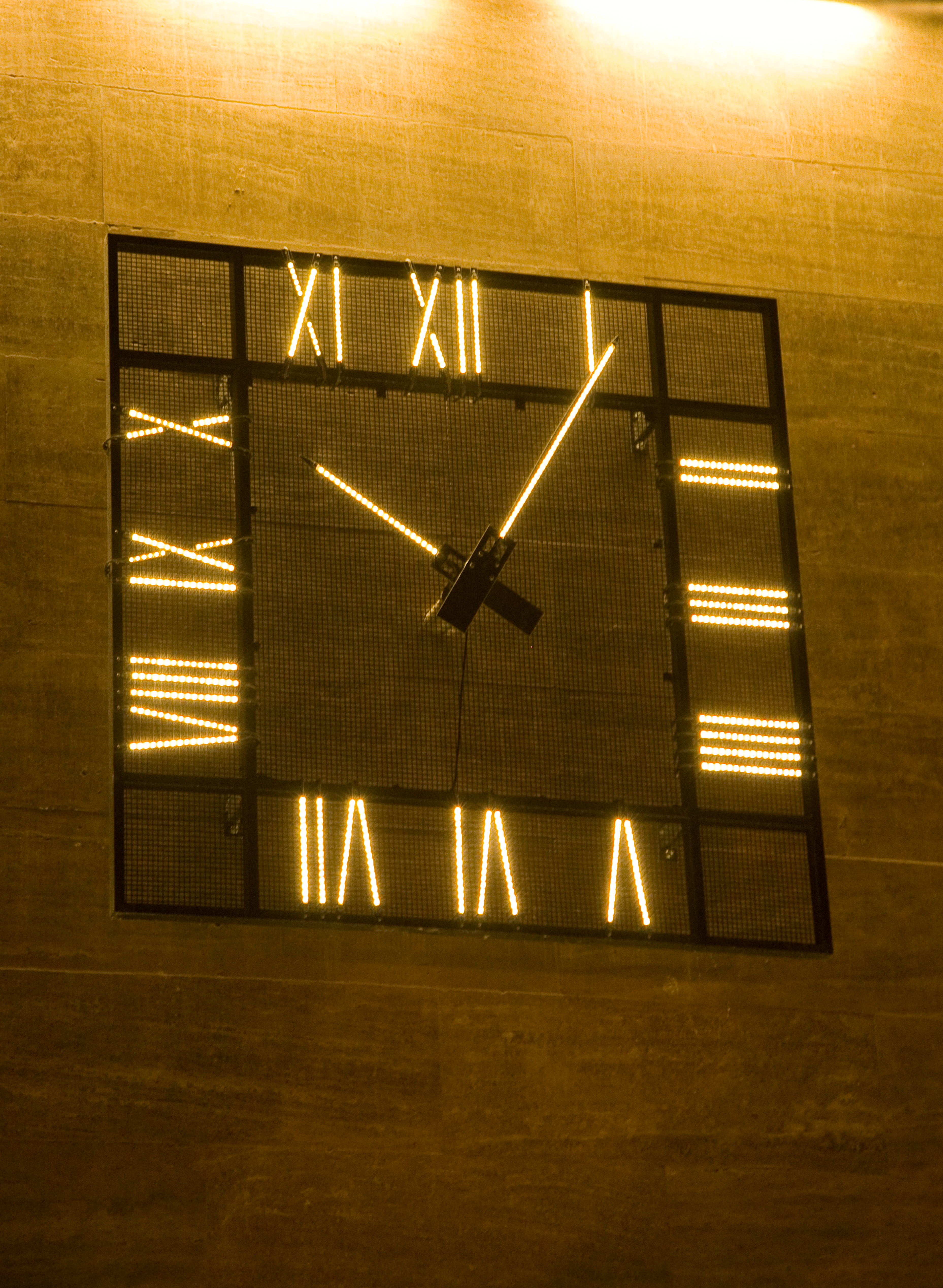 Illuminated square clock at night