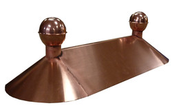 Copper finial with roof ridge