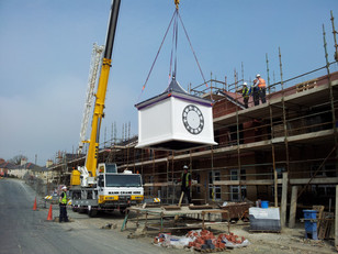 Clock tower being installed