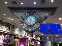 Colour illuminated clock inside shop