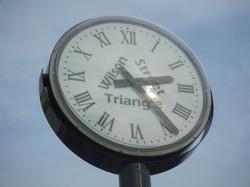 Pillar clock street sign