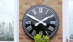 Black large outdoor clock