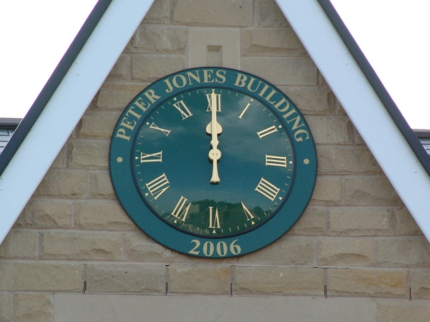 Exterior clock with signage