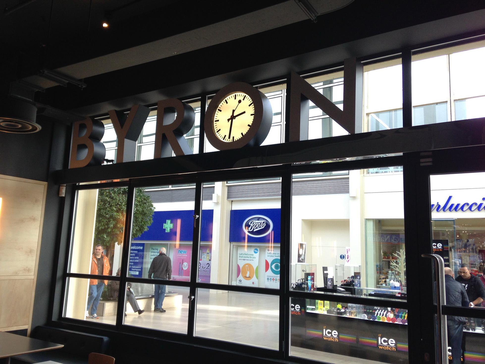 Shop front clock in sign