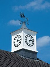 Clock tower and weathervane