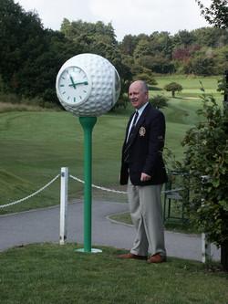 Golf ball clock on first tee
