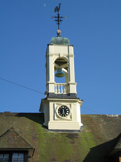 Real bell in tower with clock