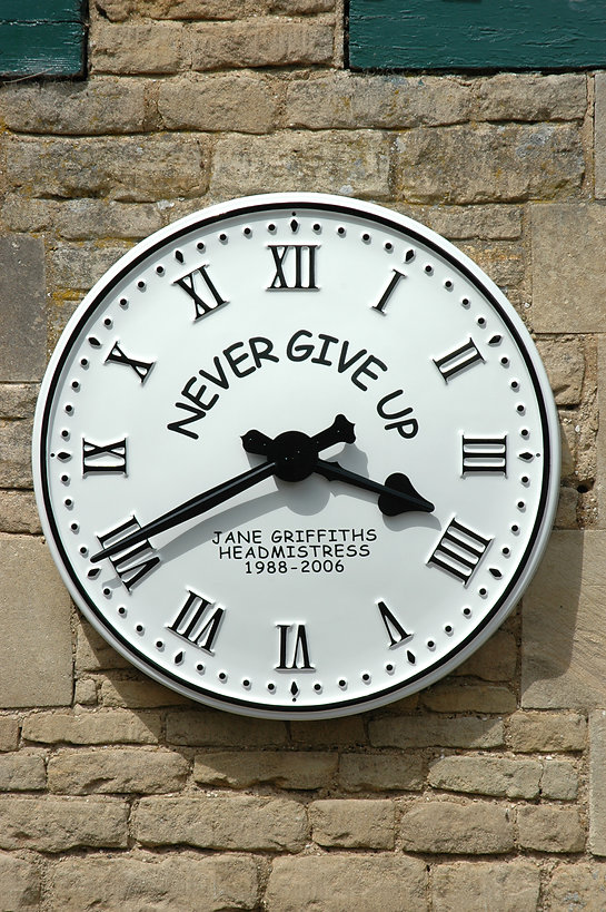 Exterior clocks with commemorative name and dates