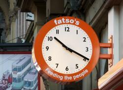 Clock outside a restaurant