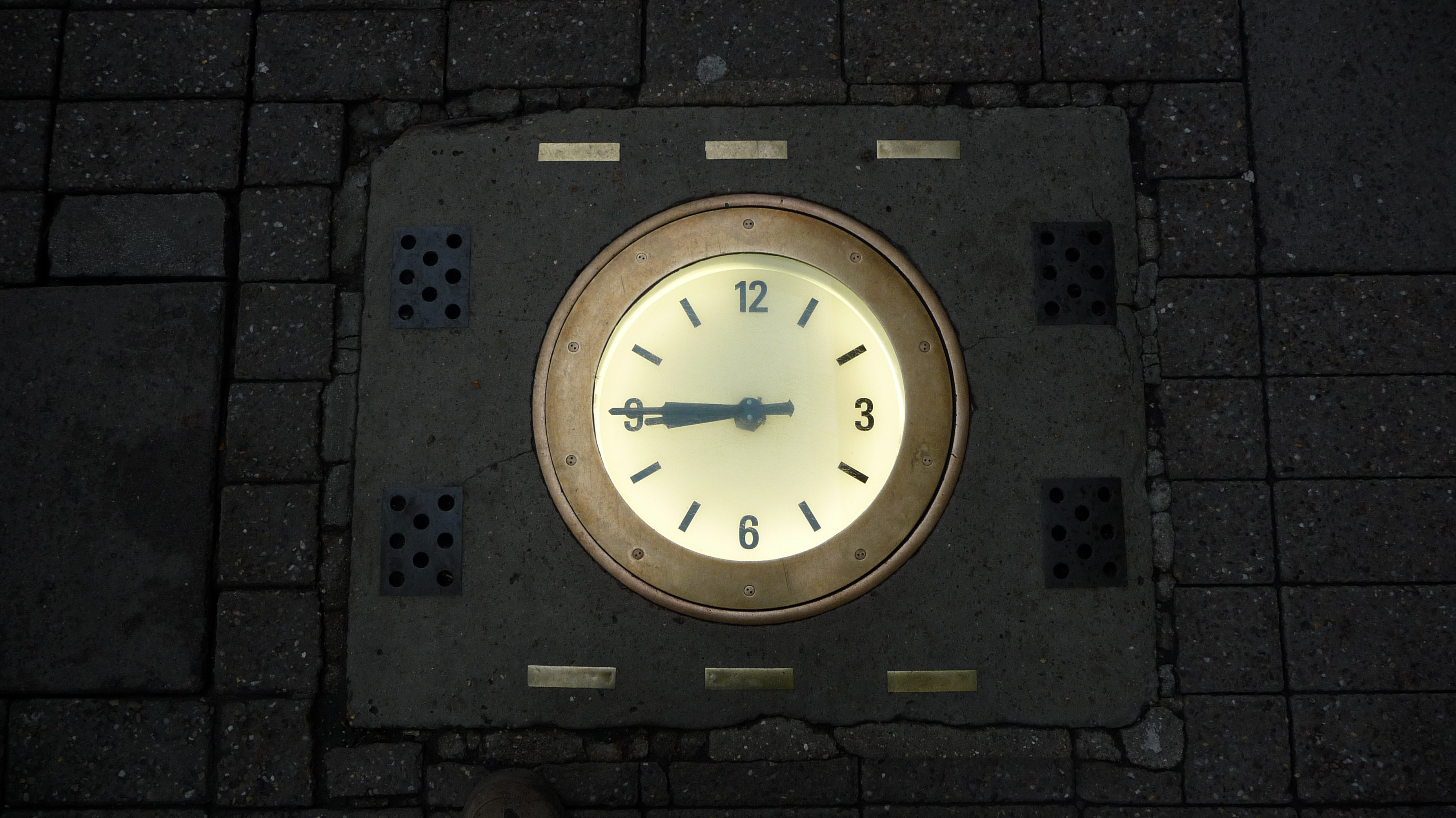 Clock built into pavement