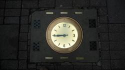 Clock built into pavement