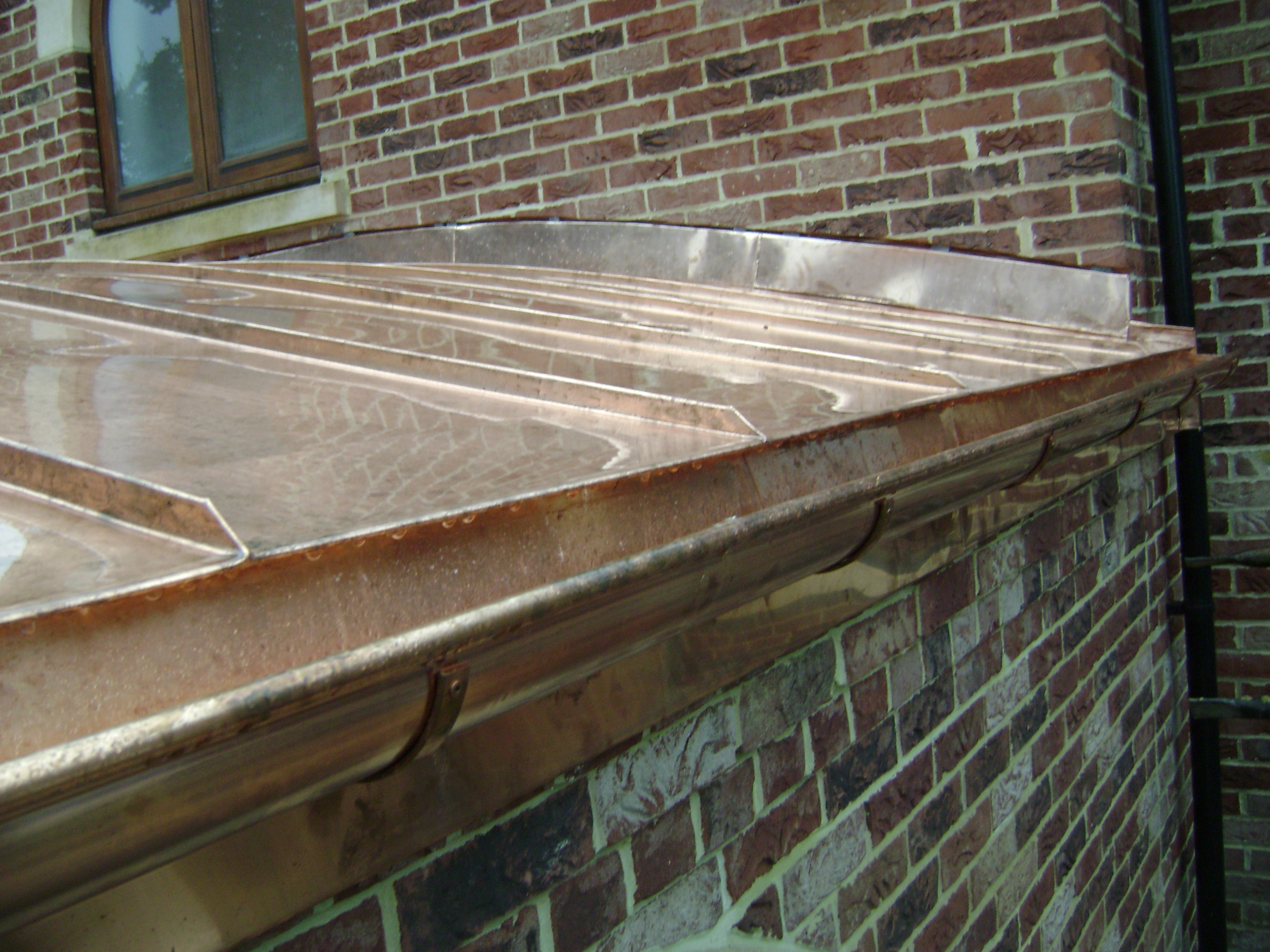 Copper roof with half round gutter