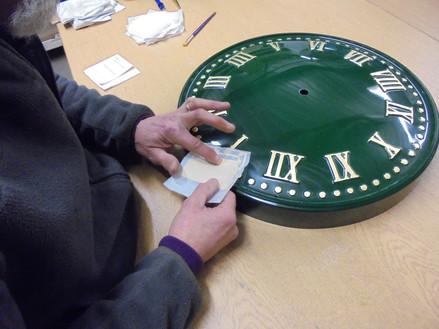 Gilding of Exterior Clocks