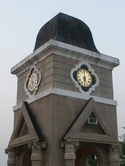 Large illuminated clocks in tower