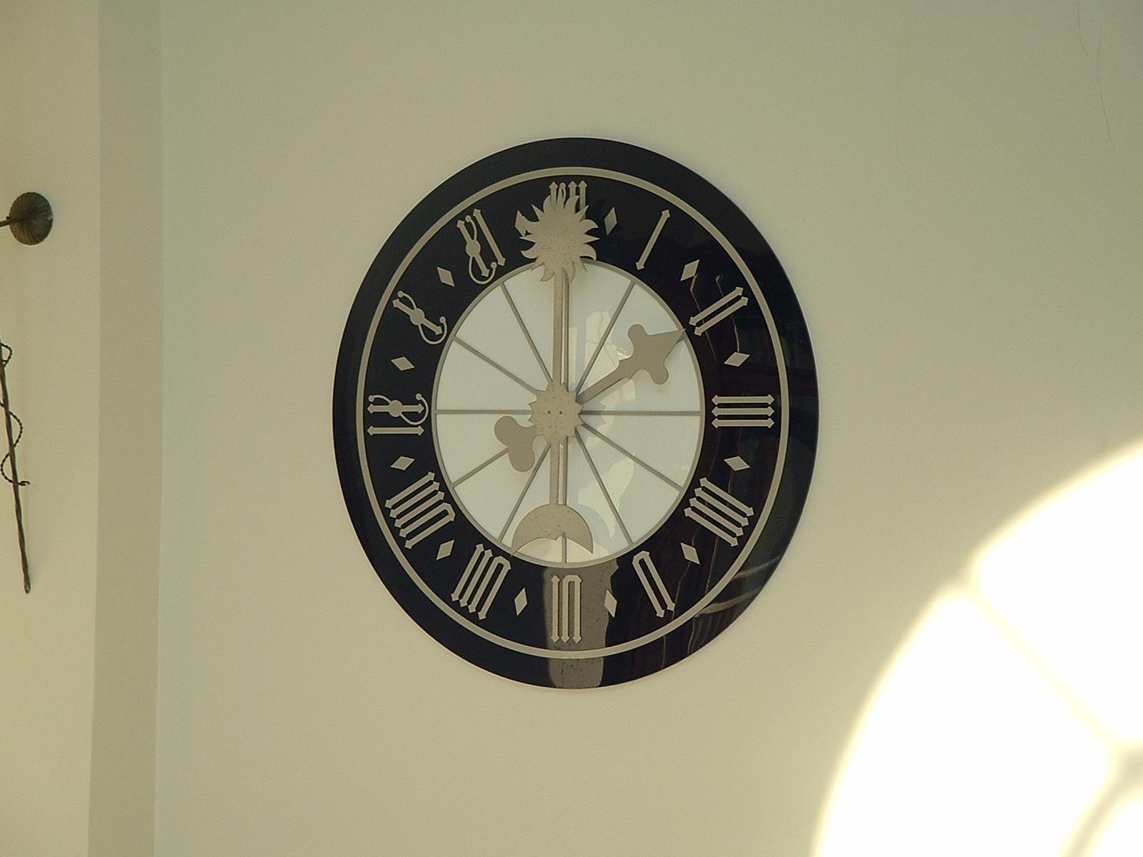 Medieval clock in swimming pool