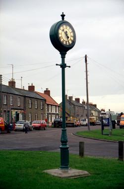 Double sided pillar clock
