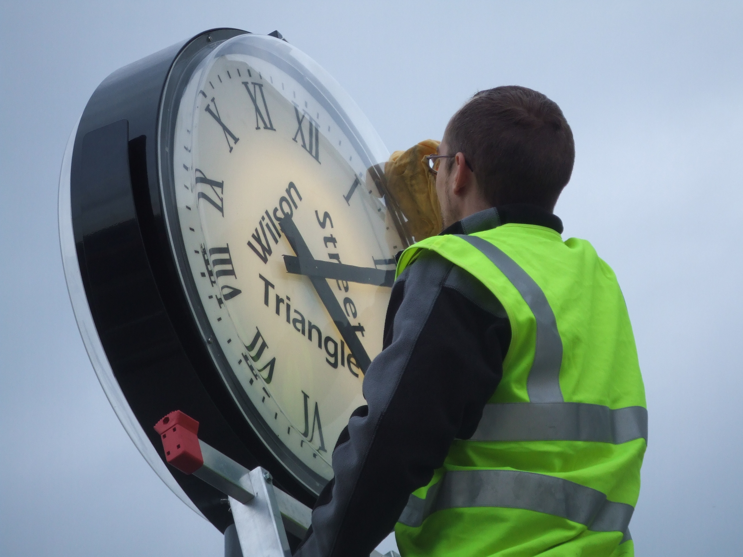 Sign written clock