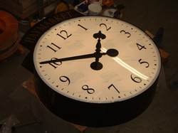 Large clock with Arabic numerals