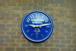 Outdoor clock with sign writing