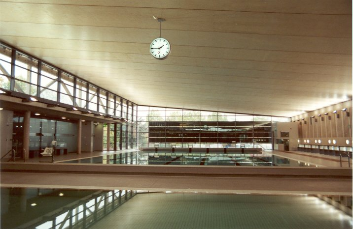 Drum clock above a swimming pool