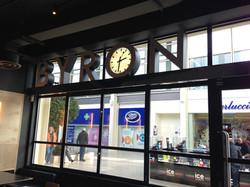 Clock in shop sign