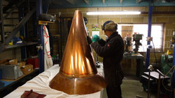 Large copper cone finial being manufactured