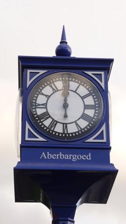 Signage panel on pillar clock