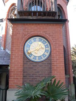 Clock in brick tower