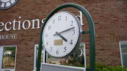 Clock with signage