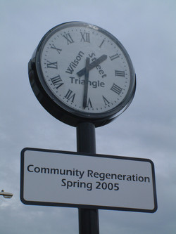 Signage on modern pillar clock