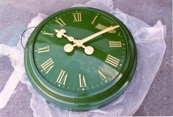 Green clock in matching bezel