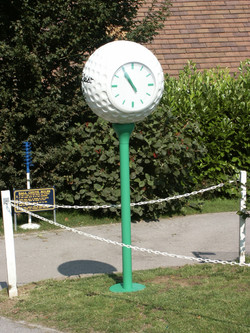 Two sided clocks on golf ball