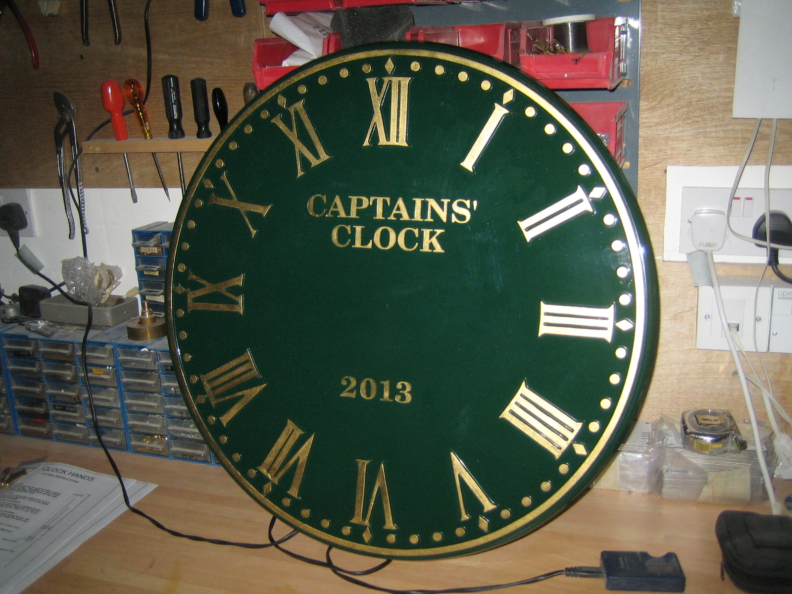 Sign written Outdoor Clock