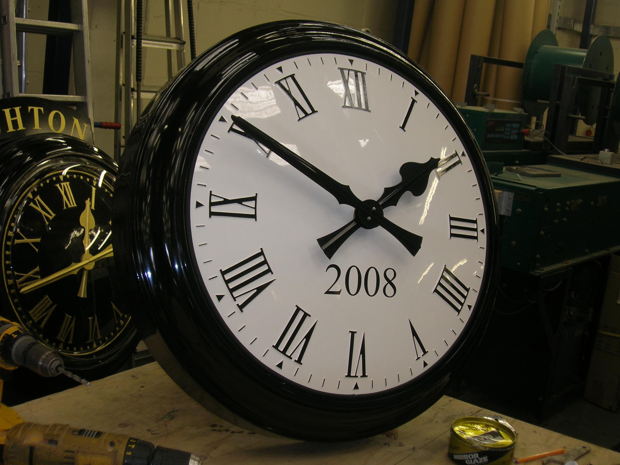 Bezel clock with sign written date