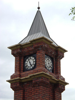 Skeleton clocks in brick pillar