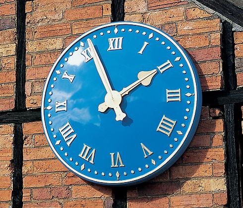 Exterior clock with Roman numerals