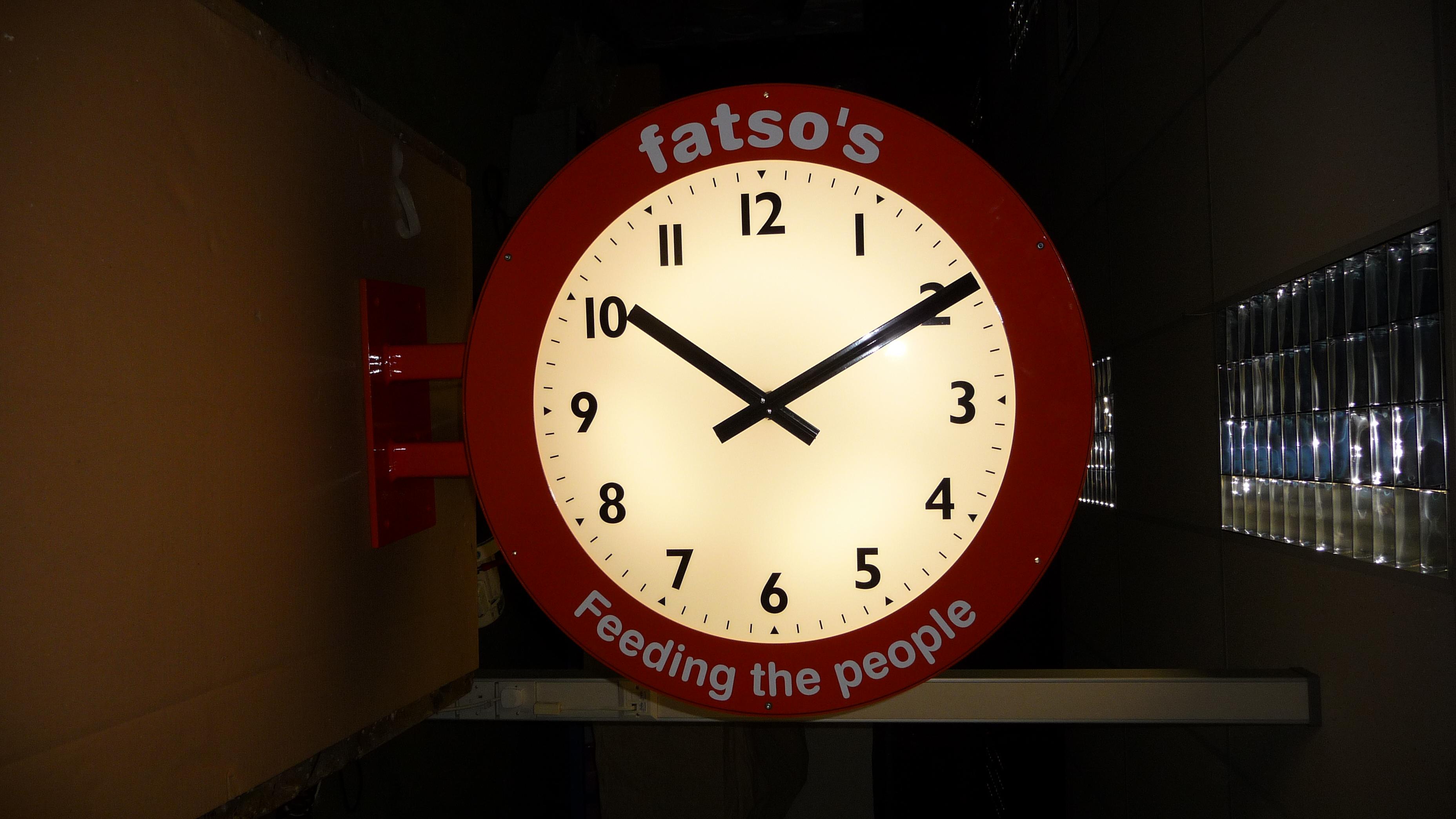 Clock advertising restaurant name