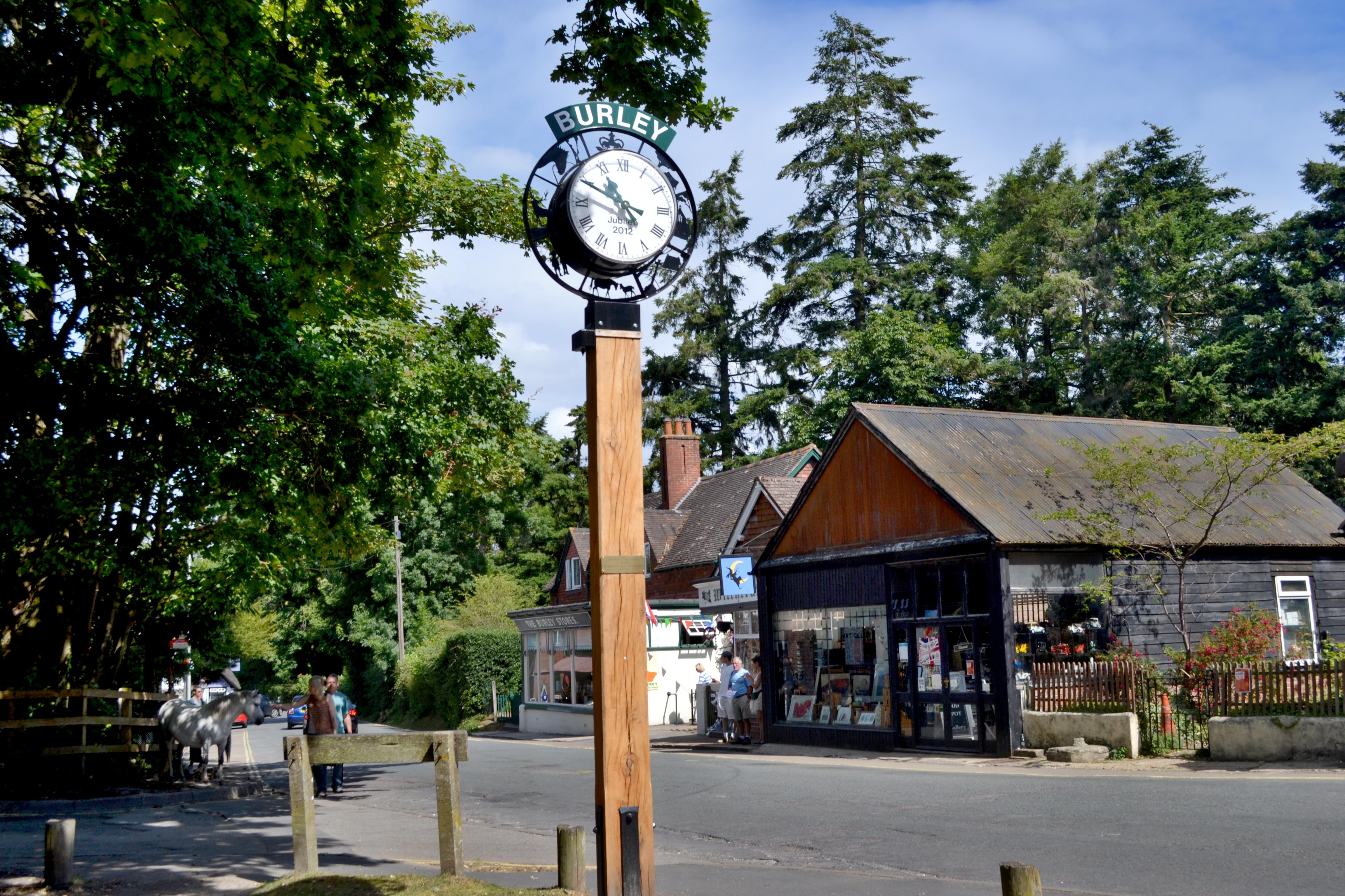 Pillar Clocks with Signage